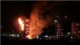 VIDEO: Tòa nhà 24 tầng bốc cháy rừng rực, người dân còn mắc kẹt