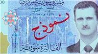 Tổng thống Al-Assad được in hình trên đồng tiền Syria